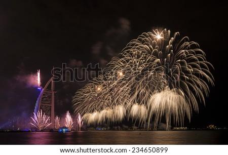 DUBAI, UAE - DECEMBER 1: UAE National Day-2014 celebration with fireworks in Burj Al Arab on December 1,2014 in Dubai, UAE - stock photo