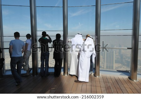 DUBAI, UAE - FEB 11: At The Top - Observation Deck of the Burj Khalifa. February 11, 2010 in Dubai, United Arab Emirates - stock photo