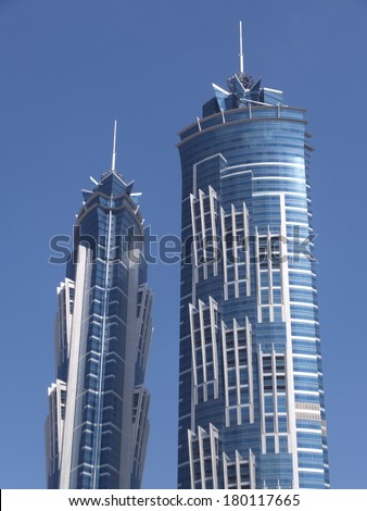 DUBAI, UAE - FEB 19: JW Marriott Marquis Dubai, UAE, as seen on February 19, 2014. It is the worlds tallest hotel, a 72-storey, 355 m (1,165 ft) twin-tower skyscraper complex. - stock photo