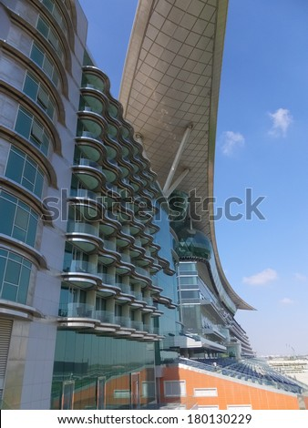 DUBAI, UAE - FEB 19: Meydan Hotel in Dubai, UAE, as seen on February 19, 2014. The Meydan is the worlds first 5-star trackside hotel with 285 rooms, 2 race tracks and the Grandstand.