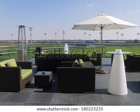 DUBAI, UAE - FEB 19: Meydan Hotel in Dubai, UAE, as seen on February 19, 2014. The Meydan is the worlds first 5-star trackside hotel with 285 rooms, 2 race tracks and the Grandstand. - stock photo