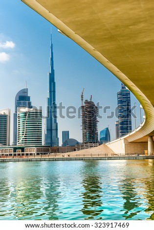 DUBAI, UAE - FEB 08: Skyline view of Dubai showing the Burj Khalifa and skyscrapers of Sheikh Zayed Road on Feb 08, 2014 in Dubai, UAE. The Burj Khalifa, the tallest skyscraper in the world at 829.8m  - stock photo