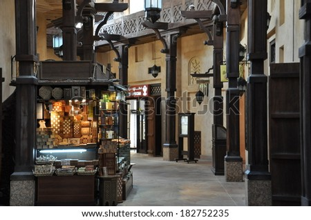 DUBAI, UAE - FEB 17: Stores at the Madinat Jumeirah Arabian Resort in Dubai, UAE, as seen on Feb 17, 2014. It is the largest resort in Dubai, spreading across  40 hectares of landscapes and gardens. - stock photo