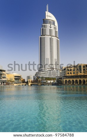 DUBAI, UAE - FEB 22: The Address Hotel in the downtown Dubai area overlooks the dancing fountains, taken on 22 February 2012 in Dubai. The hotel is surrounded by a mall, hotels and Burj Khalifa - stock photo