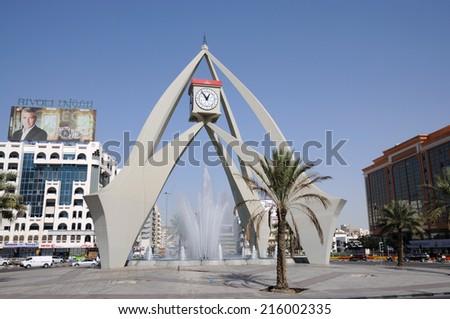 DUBAI, UAE - FEB 8: The Tower Clock Roundabout in Dubai Deira. February 8, 2010 in Dubai, United Arab Emirates - stock photo