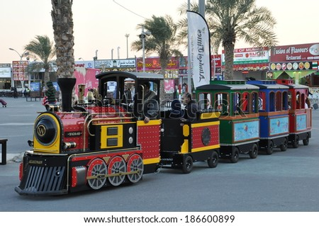 DUBAI, UAE - FEB 12: Train ride at Global Village in Dubai, UAE, as seen on Feb 12, 2014. The Global Village is claimed to be the world's largest tourism, leisure and entertainment project. - stock photo