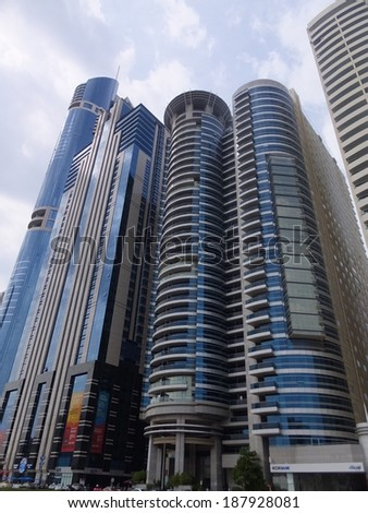 DUBAI, UAE - FEB 3: View of Sheikh Zayed Road skyscrapers in Dubai, UAE on Feb 3, 2014. The Sheikh Zayed Road (E11 highway) is home to most of Dubai's skyscrapers, including the Emirates Towers.