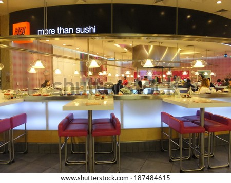 DUBAI, UAE - FEB 16: Yo Sushi at Dubai Mall in the UAE, on Feb 16, 2014,. Dubai Mall is the worlds largest shopping mall based on total area and 6th largest by gross leasable area.