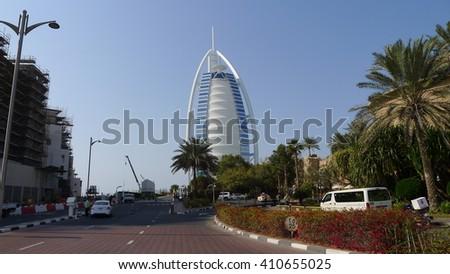 DUBAI, UAE - FEBRUARY 10: Burj Al Arab hotel on February 10, 2016 in Dubai, UAE. Burj Al Arab is a luxury 5 star hotel built on an artificial island in front of Jumeirah beach - stock photo