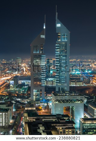 DUBAI, UAE - FEBRUARY 3 - Emirates Twin Towers, Dubai, designed by NORR Group Consultants International. One tower is 1165 feet high and the other is 1014 feet high. Picture taken on February 3, 2014. - stock photo