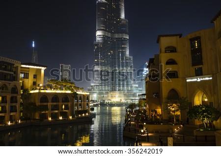 DUBAI - UAE, FEBRUARY 27 2014: Souk Al Bahar at night. It is an Arabic - style retail and dining destination located in the heart of the prestigious Downtown Dubai, overlooking The Dubai Fountain. - stock photo