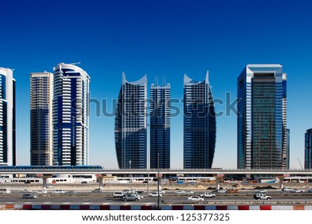 DUBAI, UAE - FEBRUARY 10 - The Sheikh Zayed Road during the rush hours. The Dubai Metro is a driverless, fully automated metro rail network in Dubai. Picture taken on February 10, 2010. - stock photo