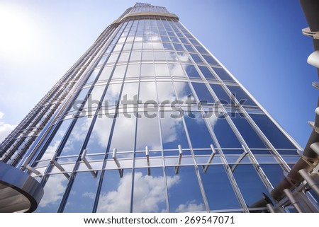 DUBAI, UAE - FEBRUARY 24: View from observation deck of Burj Khalifa- At The Top, clouds and sky reflected in glass surface of tower. Picture taken on February 24, 2015. - stock photo