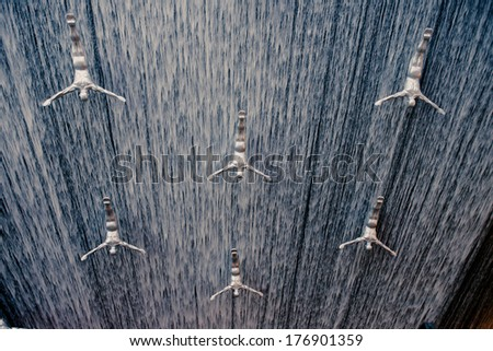 DUBAI, UAE - FEBRUARY 10: Waterfall in Dubai Mall - world's largest shopping mall based on total area and sixth largest by gross leasable area, FEBRUARY 10, 2014 in Dubai, United Arab Emirates. - stock photo