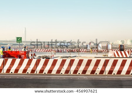 DUBAI, UAE - FEBRUARY 27, 2014: Workers in Dubai International Airport - stock photo