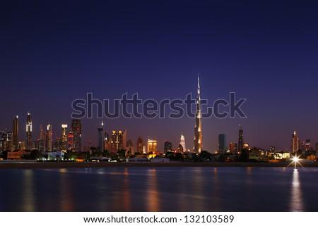DUBAI, UAE - JAN 23:  Burj Khalifa, the tallest skyscraper in the world, 829.8 m on Jan 23, 2013 in Dubai, UAE. Construction began in 2004. The building officially opened on January 4, 2010 - stock photo