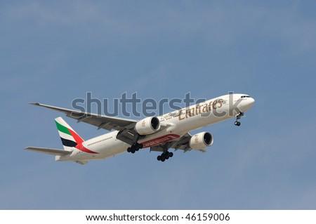 DUBAI, UAE - JAN 25: Emirates Airline Airplane Boeing 777-300 ER lands at Dubai International Airport January 24, 2010 Dubai, United Arab Emirates - stock photo