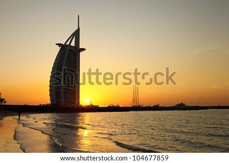 DUBAI, UAE - JANUARY 3: Burj Al Arab hotel on January 3, 2012 in Dubai. Burj Al Arab is a luxury 5 stars hotel built on an artificial island in front of Jumeirah beach. - stock photo
