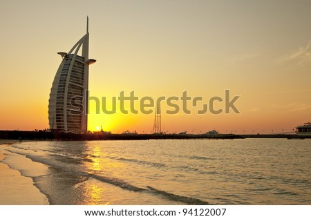 DUBAI, UAE - JANUARY 3: Burj Al Arab hotel on January 3, 2012 in Dubai. Burj Al Arab is a luxury 5 stars hotel built on an artificial island in front of Jumeirah beach. Sunset View