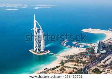 DUBAI, UAE - JANUARY 20: Burj Al Arab hotel on January 20, 2011 in Dubai, UAE. Burj Al Arab is a luxury 5 star hotel built on an artificial island in front of Jumeirah beach. Helicopter view - stock photo