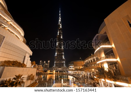 DUBAI, UAE - JANUARY 13: Burj Khalifa Night Shot from Dubai Mall on January 13, 2013 in Dubai, UAE. Burj Khalifa is located on Sheikh Zayed Road and is the tallest building of the world, at 828m. - stock photo