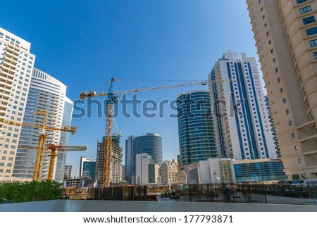 DUBAI, UAE-JANUARY 15: City streets January 15, 2014 in Dubai, UAE. City streets at day light.