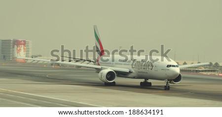 Dubai, UAE - JANUARY 12: Emirates Boeing 777-200 taxis to teminal at Dubai International0 Airport Terminal 3 on January 12, 2014. Emirates is an airline based in Dubai. - stock photo