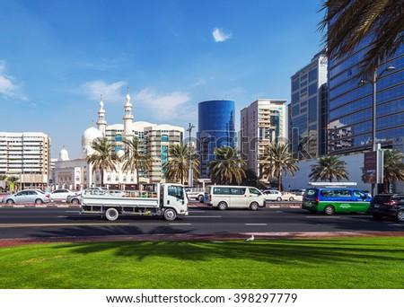 DUBAI, UAE - JANUARY 23: People on the street, architecture of Dubai's many highrise exterior buildings. Dubai with many traditional arabic shops street market. Dubai, UAE circa January 2016 - stock photo
