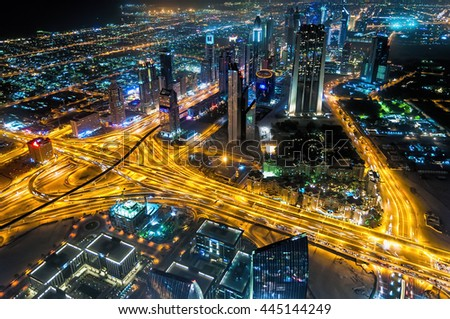 """Dubai, UAE - January 06, 2012: Sheikh Zayed Road night view from Burj Kalifa """"At the Top"""". The Sheikh Zayed Road is home to most of Dubai's skyscrapers, including the Emirates Towers and Burj Kalifa. - stock photo"""