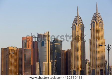 DUBAI, UAE - JANUARY 7: Sunset and modern skyscrapers in Dubai Marina with clear blue sky. United Arab Emirates in 2016