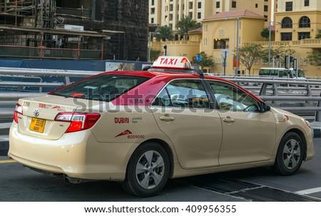 Dubai, UAE - January 24, 2016: Taxi in the city of Dubai - Dubai has an extensive taxi system RTA. - stock photo