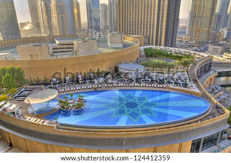 DUBAI, UAE - JANUARY 8: The Address Hotel Marina swimming pool on January 8, 2012 in Dubai, UAE. The Address Hotel standing tall in the heart of one of Dubai's most vibrant neighborhoods. - stock photo