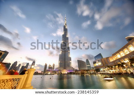 DUBAI, UAE - JANUARY 16, 2014: View at Burj Khalifa in Dubai. This skyscraper is the tallest man-made structure ever built, at 828 m. - stock photo