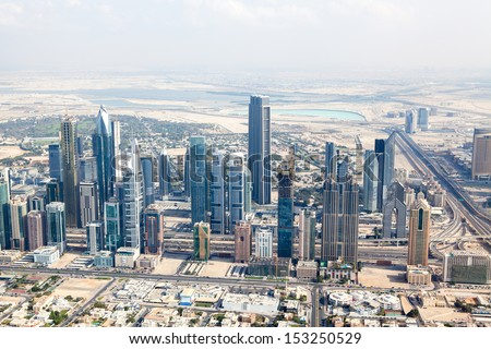 DUBAI, UAE - JANUARY 20: View at Sheikh Zayed Road skyscrapers in Dubai at January 20, 2011. More than 25 skyscrapers taller than 100 meters and the highest building Burj Khalifa can be found there - stock photo