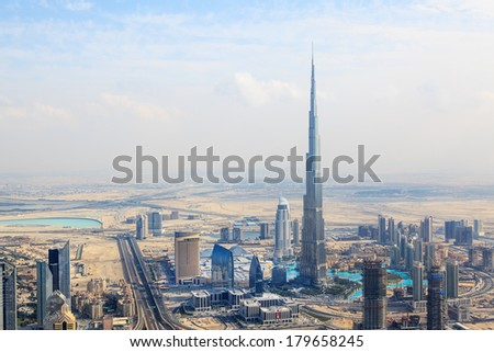 DUBAI, UAE - JANUARY 20: View at Sheikh Zayed Road skyscrapers in Dubai at January 20, 2011.  the highest building in the wordl Burj Khalifa can be found there - stock photo