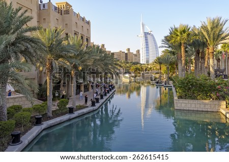 Dubai, UAE - January 08, 2012: View of Burj Al Arab from Madinat Jumeirah. Madinat is a luxurious resort in Dubai and is also the largest resort in the emirates spreading across over 40 hectares. - stock photo