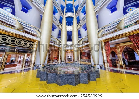 Dubai, UAE - January 08, 2012: View of Burj Al Arab lobby. Burji Al Arab is a luxury hotel located in Dubai, United Arab Emirates. At 321 m (1,053 ft), it is the fourth tallest hotel in the world. - stock photo