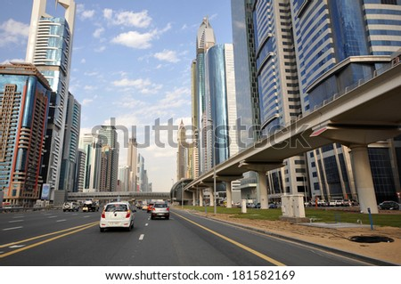 DUBAI, UAE - JANUARY 9, 2013: View of skyscrapers and Dubai Metro along Sheikh Zayed Road. It is 558.4 km long and home to most of the Dubai's tallest skyscrapers. January 9, 2013. Dubai, UAE