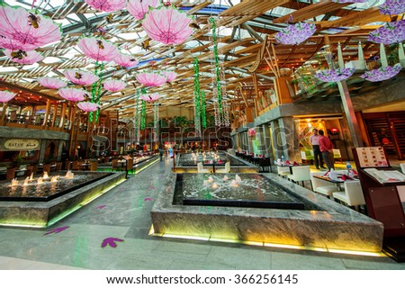 DUBAI, UAE - JANYARY 15: BurJuman shopping mall in Dubai, UAE as seen on Jenyary 15, 2016. It was the second major shopping mall to be opened in Dubai. - stock photo