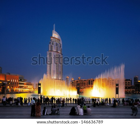 DUBAI, UAE - JUL3 : The Dubai Fountain on Jul 3, 2013 in Dubai. Dubai's best attraction, with 6600 lights, 275 m long and shoots water up to 150 m into the air accompanied by a range of world music