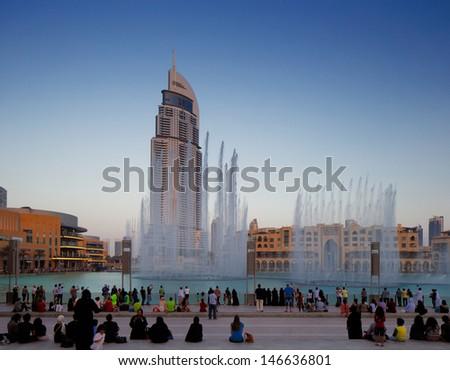 DUBAI, UAE - JUL 3: The Dubai Fountain on Jul 3, 2013 in Dubai, UAE. The Dubai Fountain is the worlds largest choreographed fountain system set on the 30-acre manmade Burj Khalifa Lake - stock photo