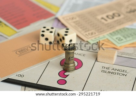 DUBAI, UAE - JULY 10, 2015: Monopoly Board Game Closeup. The classic real estate trading game from Parker Brothers was first introduced to America in 1935. - stock photo