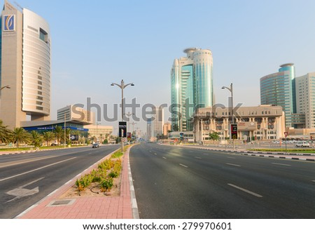 DUBAI, UAE - 16 JULY 2014: The beautiful, ultra-modern architecture of Dubai's many highrise buildings is evident along this central highway. - stock photo