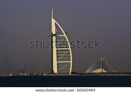 DUBAI, UAE - JULY 05: The grand sail shaped Burj al Arab Hotel taken July 5, 2010 in Dubai. The hotel is classed as one of the most luxurious in the world and is located on a man made island. - stock photo