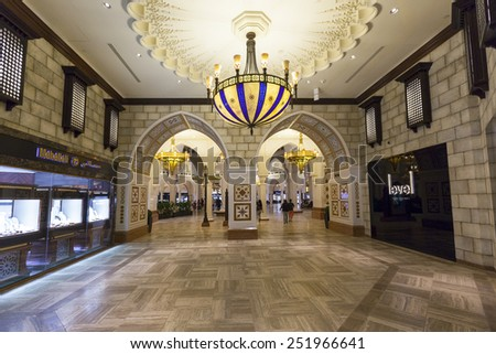 DUBAI, UAE - 5 JUN 2014: People walking in Mall of the Emirates in Dubai, UAE. Mall of the Emirates is multi-level shopping center with over 700 stores. The largest shopping mall by are in the world.  - stock photo