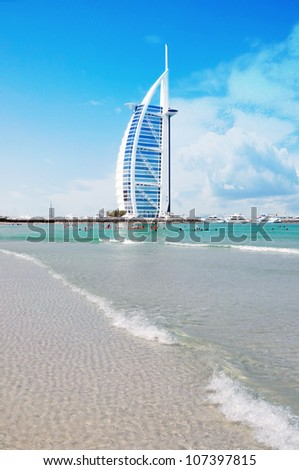 DUBAI, UAE - JUNE 8: Burj Al Arab hotel on June 8, 2012 in Dubai. Burj Al Arab is a luxury 5 star hotel built on an artificial island in front of Jumeirah beach. - stock photo