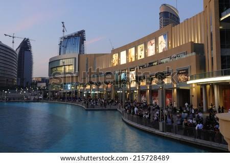 DUBAI, UAE - MAR 4: The Dubai Mall at dusk. Biggest mall in the Middle East. March 4, 2010 in Dubai, United Arab Emirates - stock photo