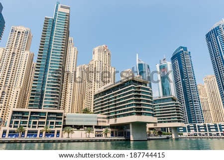 DUBAI, UAE - MARCH 27, 2014: A skyline panoramic view of Dubai Marina. Dubai Marina is an artificial 3 km canal carved along the Persian Gulf shoreline.