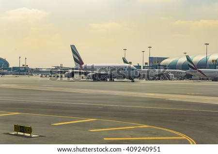 DUBAI, UAE - MARCH 3 2014: Airbus A380 in Dubai airport. Dubai International Airport is a major airline hub in the Middle East, and is the main airport of Dubai.