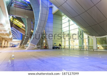 DUBAI, UAE - MARCH 24: Arches of terminal 3 at Dubai International Airport on March 24, 2014. This is the worlds largest airport terminal with over 1,713,000 m2 exclusively for Emirates airlines. - stock photo